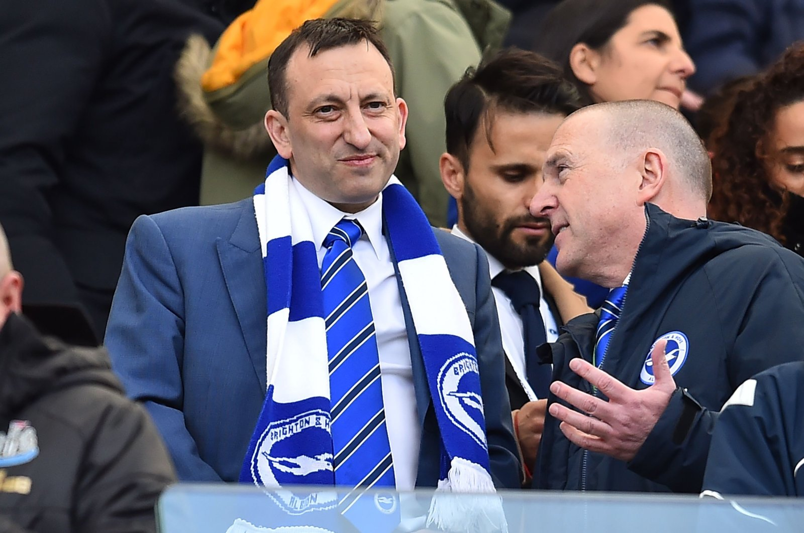 Tony Bloom (L) takes his seat before a Premier League match in Brighton, England, April 27, 2019. (AFP Photo)