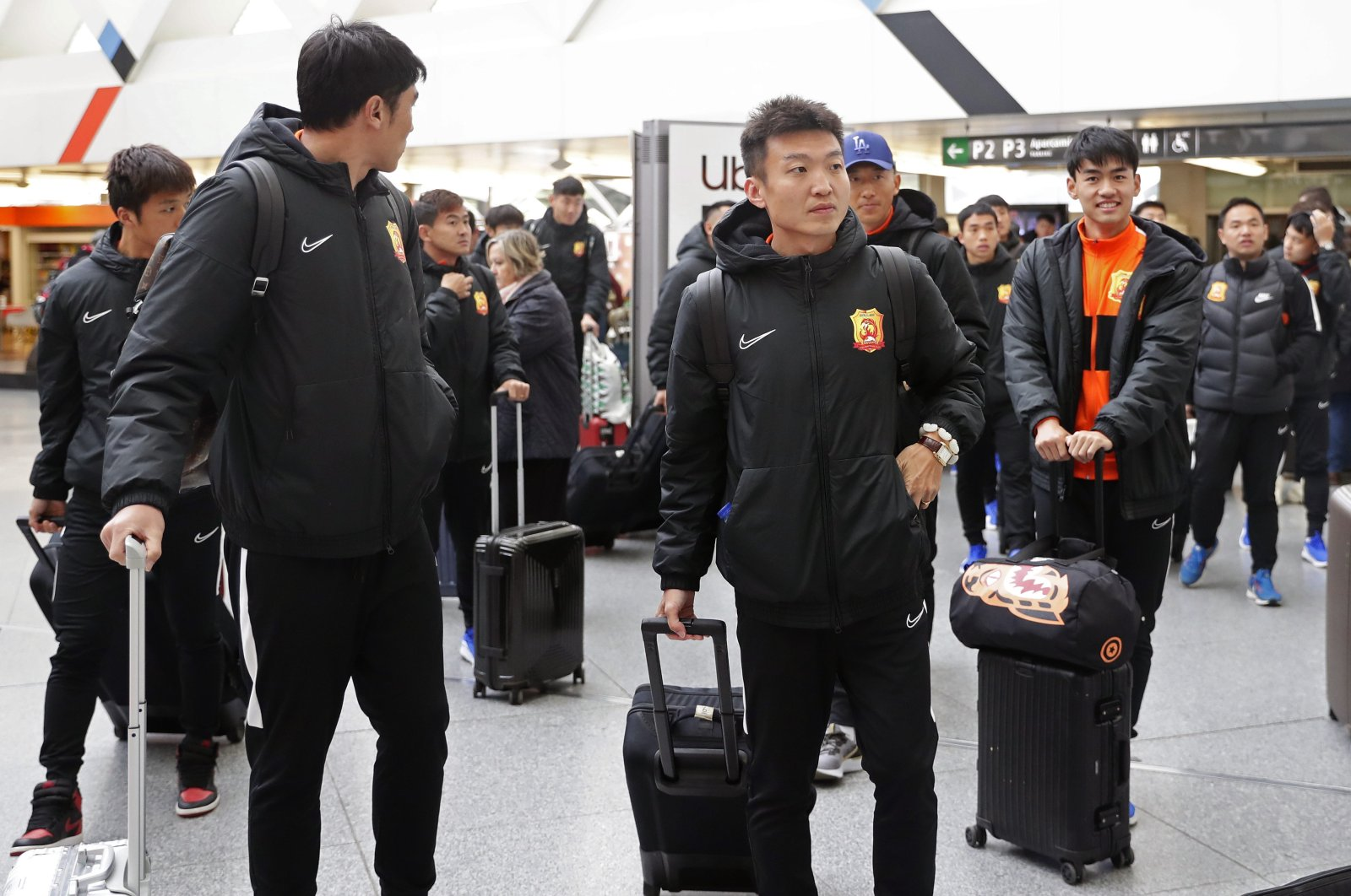 Players of the Chinese Super League team Wuhan Zall arrive at the Atocha train station in Madrid, Spain, Saturday, Feb. 29, 2020. (AP Photo)