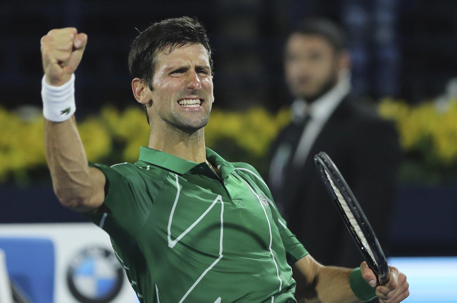 Novak Djokovic celebrates after he beating Stefanos Tsitsipas in the final match of the Dubai Duty Free Tennis Championship in Dubai, United Arab Emirates, Feb. 29, 2020. (AP Photo)