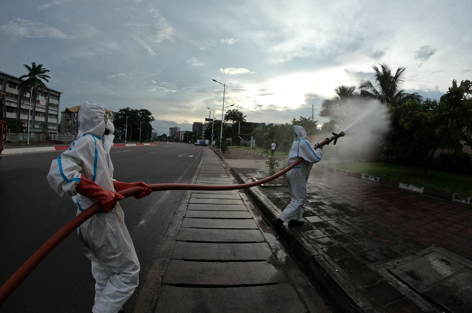 Congolese firemen begin disinfecting operations in state buildings and public spaces in the Gombe district of Kinshasa, April 12, 2020. (AFP Photo)