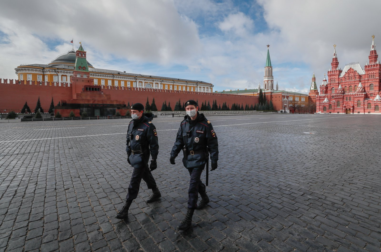 Police officers wearing protective masks walk on the Red Square in front of the Kremlin in Moscow, Russia, 17 April 2020. (EPA-EFE/YURI KOCHETKOV Photo)