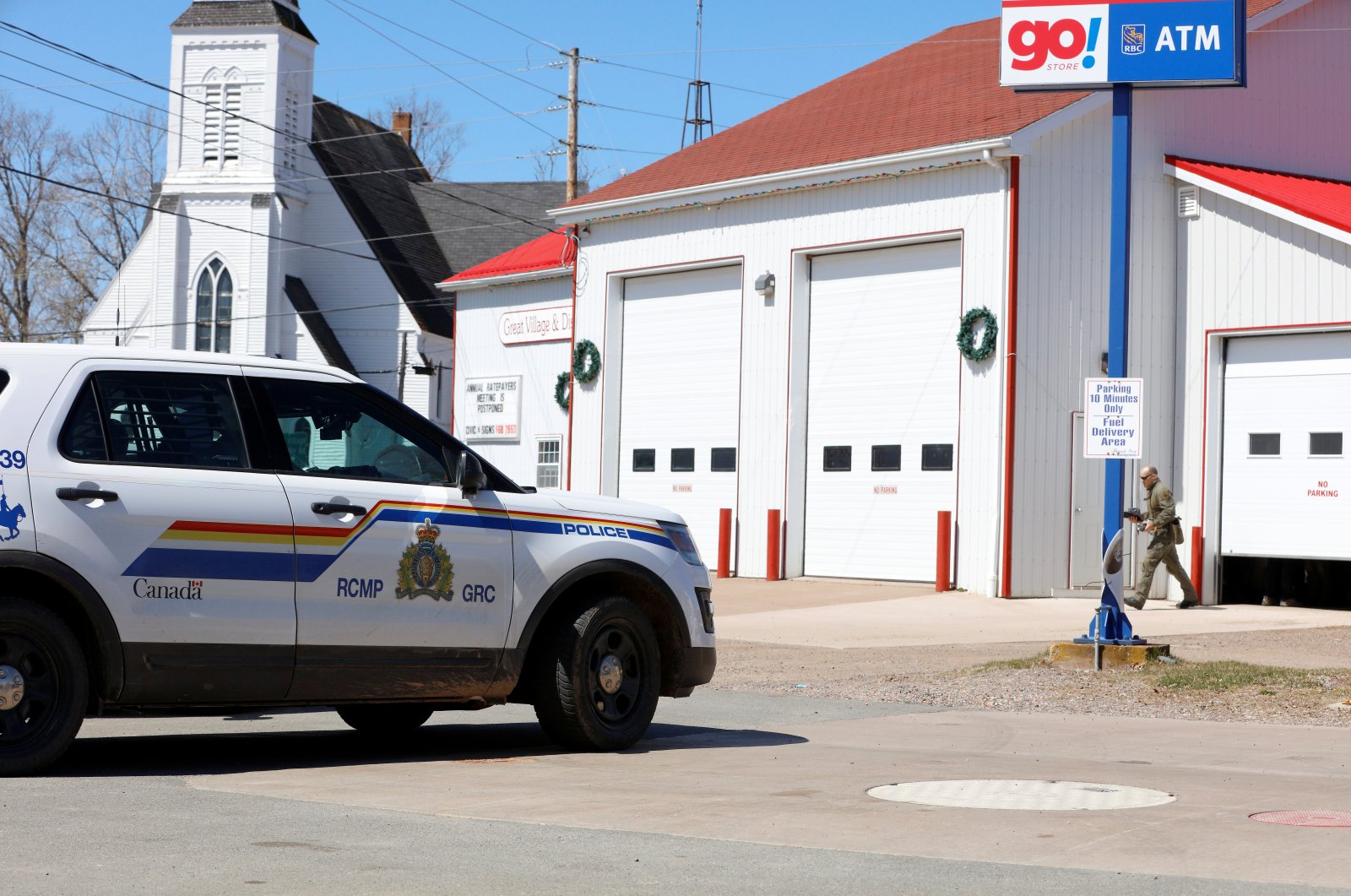 A Royal Canadian Mounted Police (RCMP) member walks out of the Great Village command post after searching for Gabriel Wortman, who they describe as a shooter of multiple victims, in Great Village, Nova Scotia, Canada, April 19, 2020. (Reuters Photo)