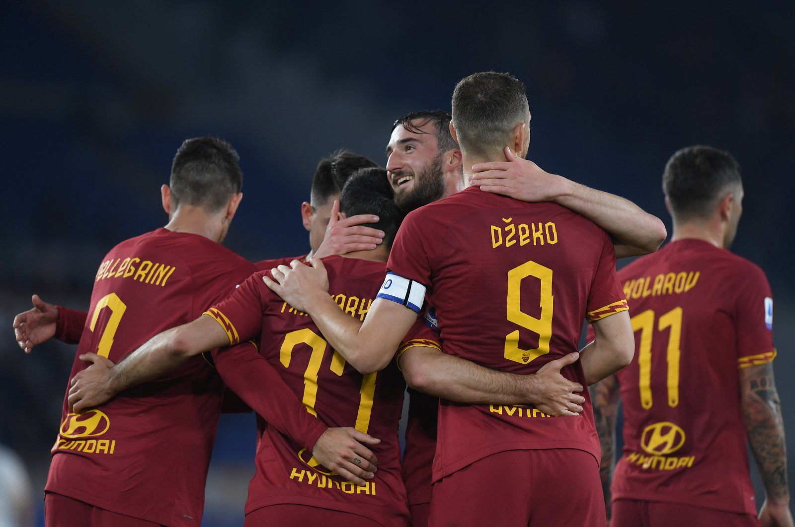 Henrikh Mkhitaryan celebrates scoring AS Roma's second goal against Lecce with Bryan Cristante and teammates, Stadio Olimpico, Rome, Italy, Feb. 23, 2020. (Reuters Photo)