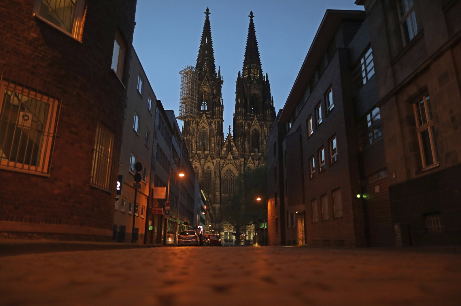 An alley by the cathedral is deserted in Cologne, North Rhine-Westphalia, Germany, April 15, 2020. (AP Photo)