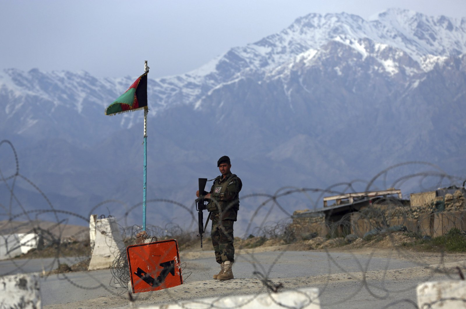 An Afghan National Army soldier stands guard at a checkpoint near the Bagram base north of Kabul, Afghanistan, April 8, 2020. (AP Photo)