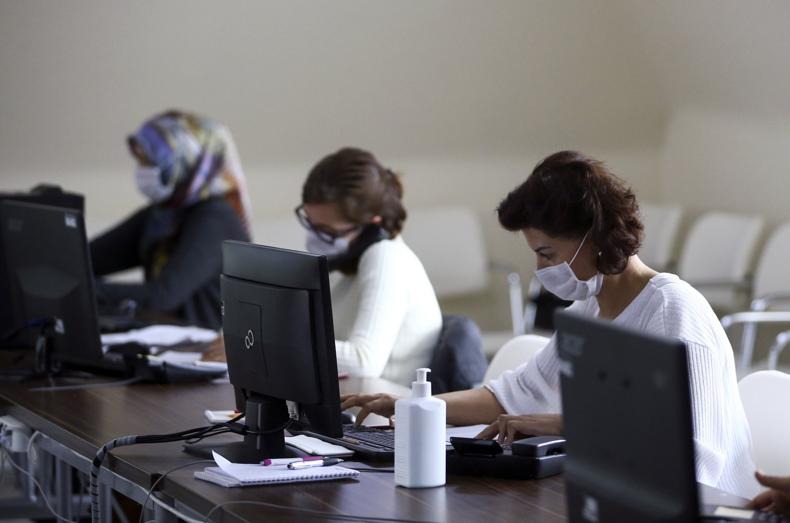A team of health experts answers people's calls regarding the COVID-19 outbreak at a call center set up by the Ministry of Health, Ankara, Turkey, April 15, 2020. (AA Photo)
