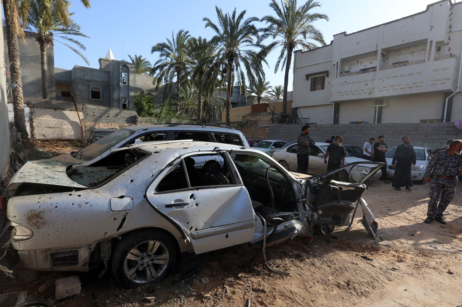 Libyans check the site of shelling on the residential area of souq al-Gomaa, north of the Libyan capital Tripoli, on April 17, 2020. (AFP)