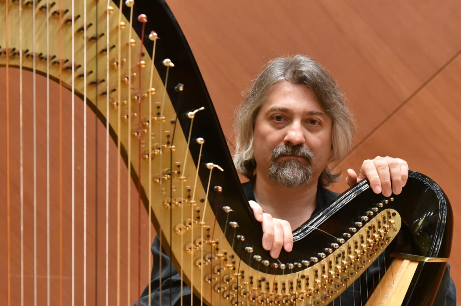 Çağatay Akyol poses with his harp in this undated photo.