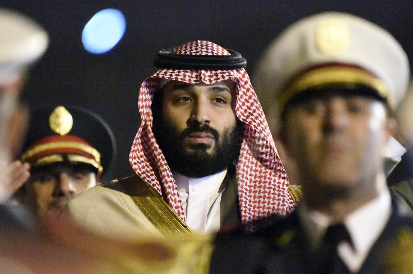 Saudi Crown Prince Mohammed Bin Salman, known for his grave human rights record, is seen behind a military band upon his arrival at Algiers International Airport, southeast of the capital Algiers on Dec. 2, 2018. (AFP Photo)