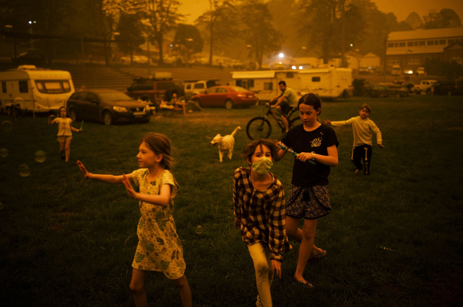Abigail Ferris (C) plays with friends at a temporary evacuation center for bushfire victims in Bega, New South Wales, Australia, Dec. 31, 2019. (AP Photo)