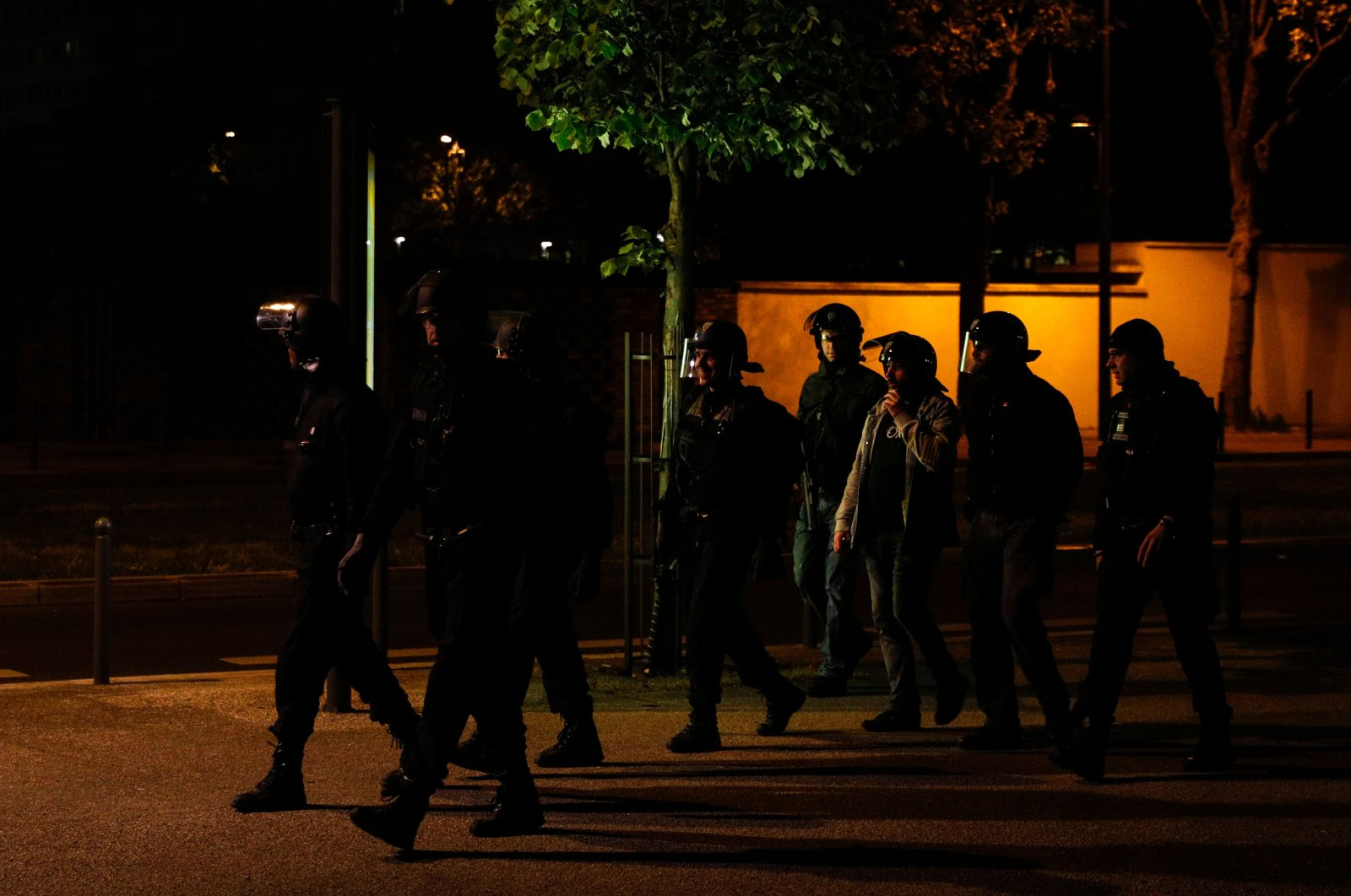 Plainclothes police and CRS anti-riot police officers walk in Villeneuve-la-Garenne, in the northern suburbs of Paris, early on April 20, 2020. (AFP Photo)
