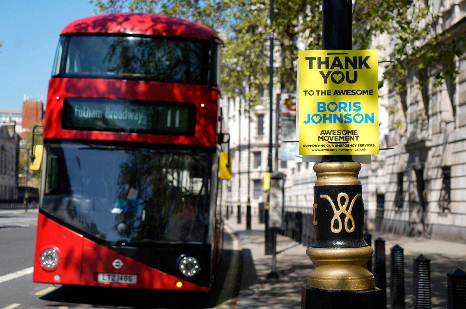 A sign in support of Britain's Prime Minister Boris Johnson is attached to a lamp post in central London, April 20, 2020. (AFP Photo)