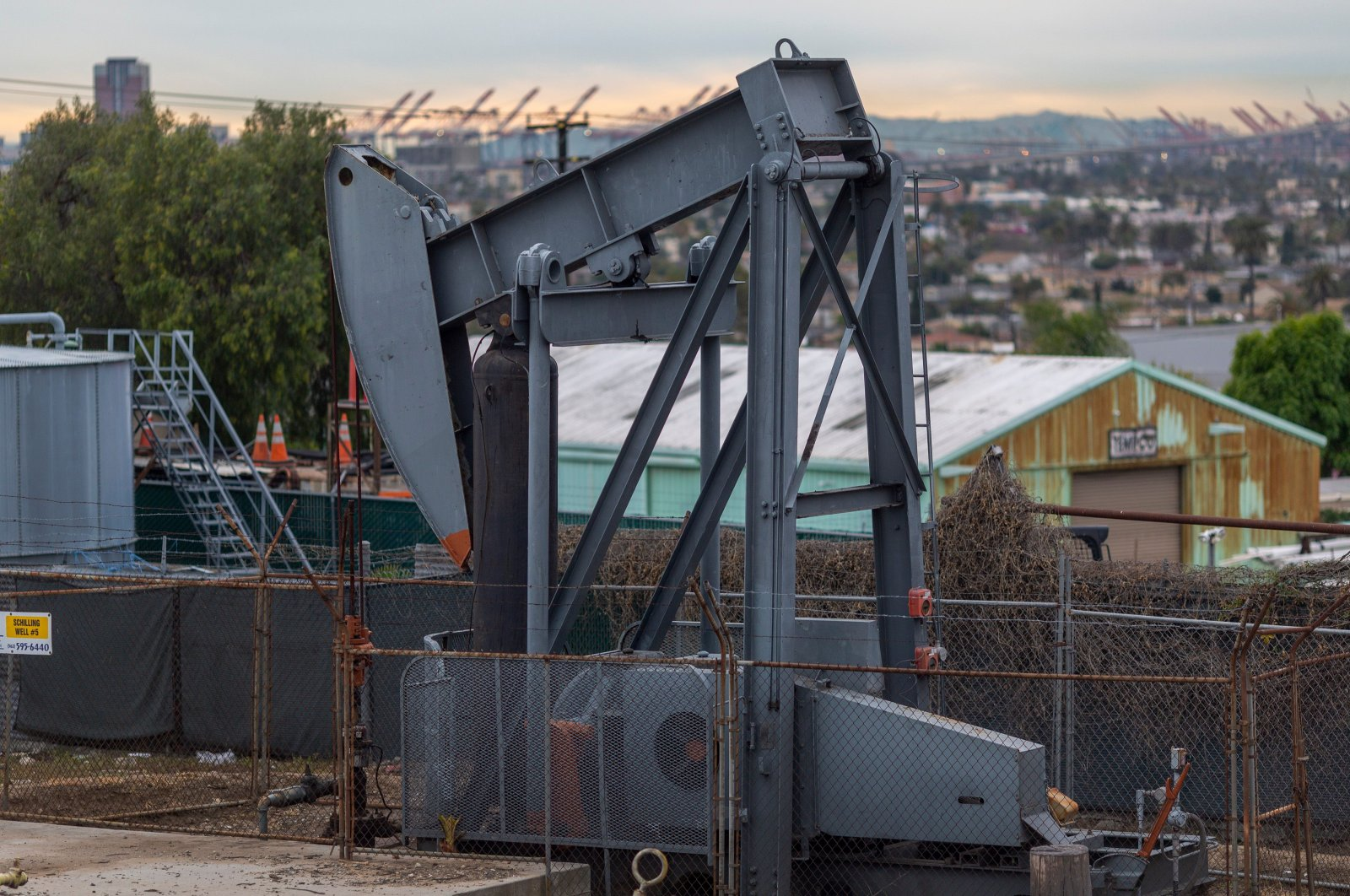 Pump jacks draw crude oil from the Long Beach Oil Field in Signal Hill, California, March 9, 2020. (AFP Photo)