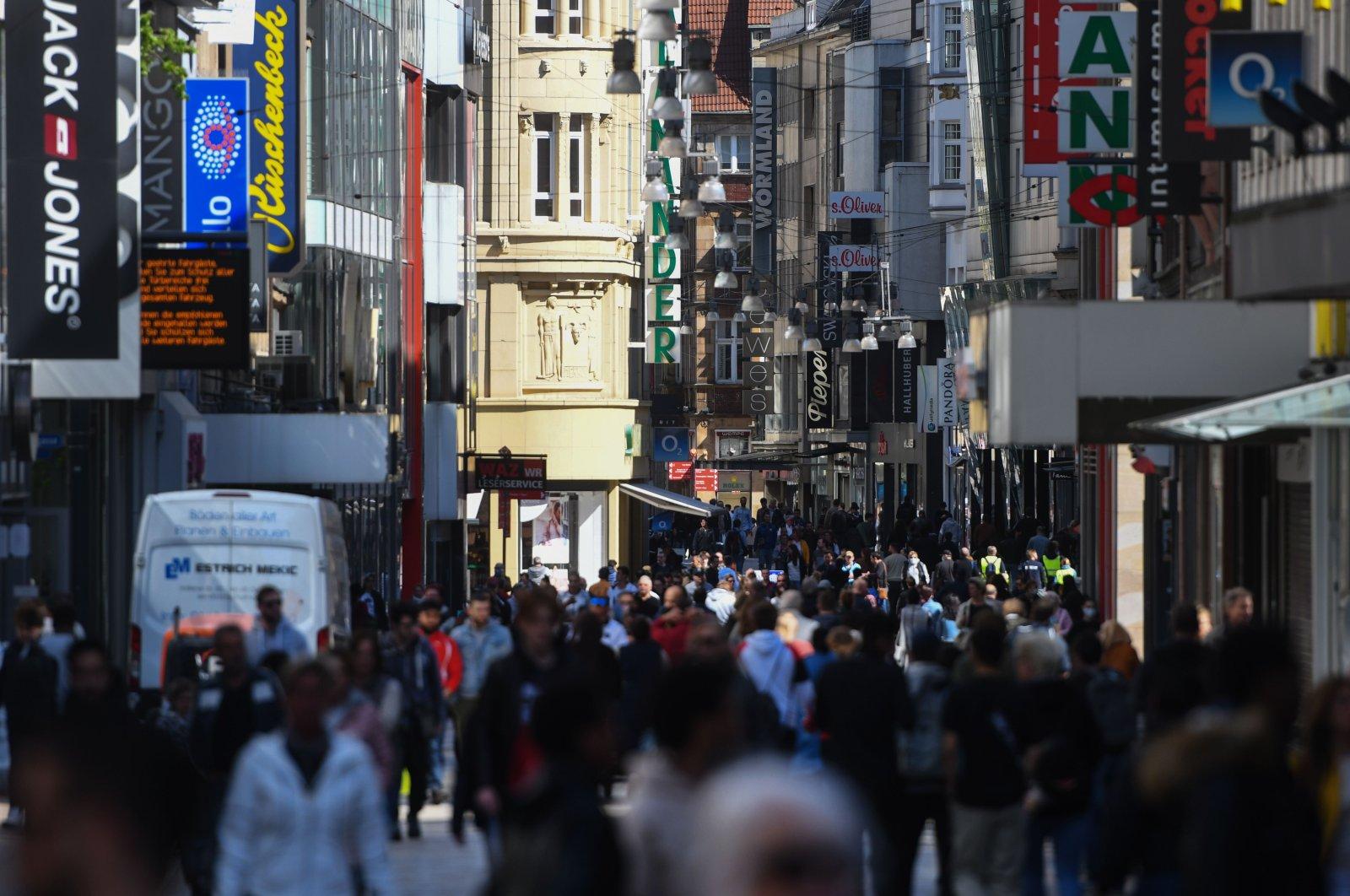 People walk past shops on a pedestrian street in Dortmund, western Germany, April 20, 2020. (AFP Photo)