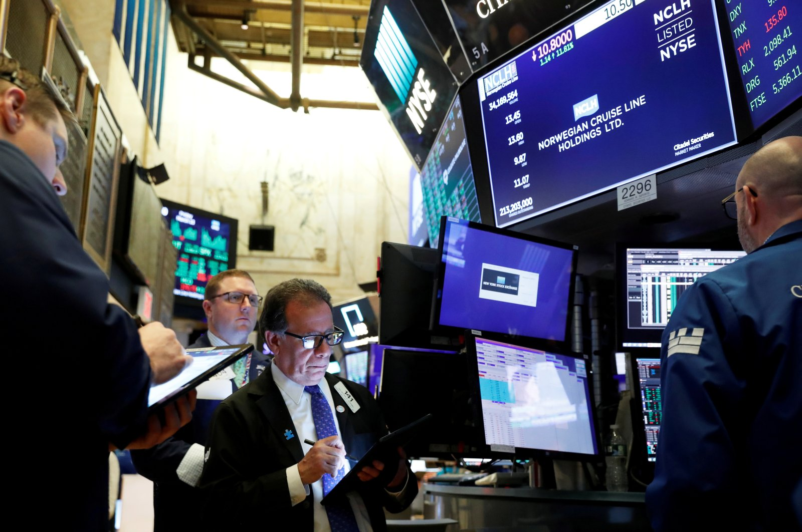 Traders wait for stocks to resume trading on Norwegian Cruise Lines Holding Ltd. on the floor of the New York Stock Exchange in New York City, U.S., March 13, 2020. (Reuters Photo)