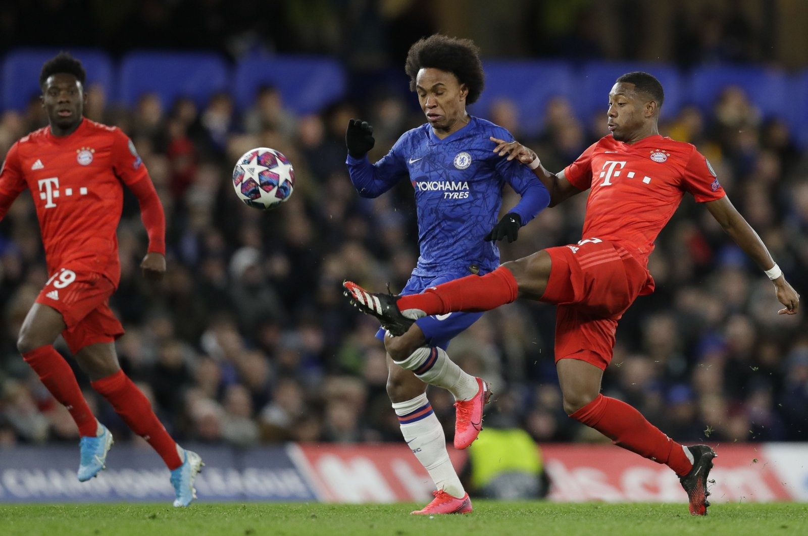Bayern Munich's David Alaba challenges Chelsea's Willian during a Champions League match in London, England, Feb. 25, 2020. (AP Photo)