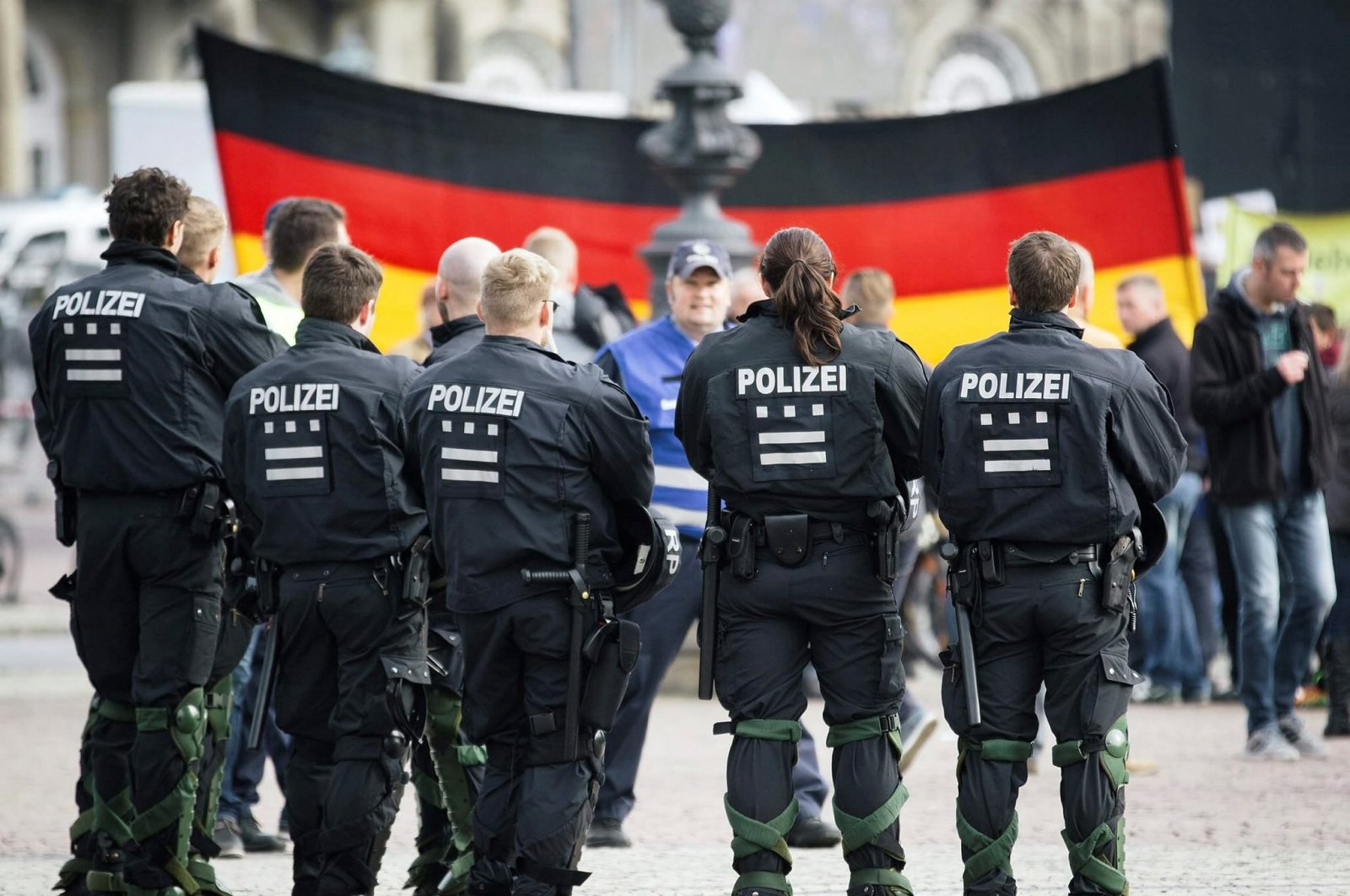 Thousands of supporters of the anti-migrant organization Pegida gathered in the east German city of Dresden to celebrate the second anniversary of the group's founding, Oct. 17, 2016. (Sabah File Photo)