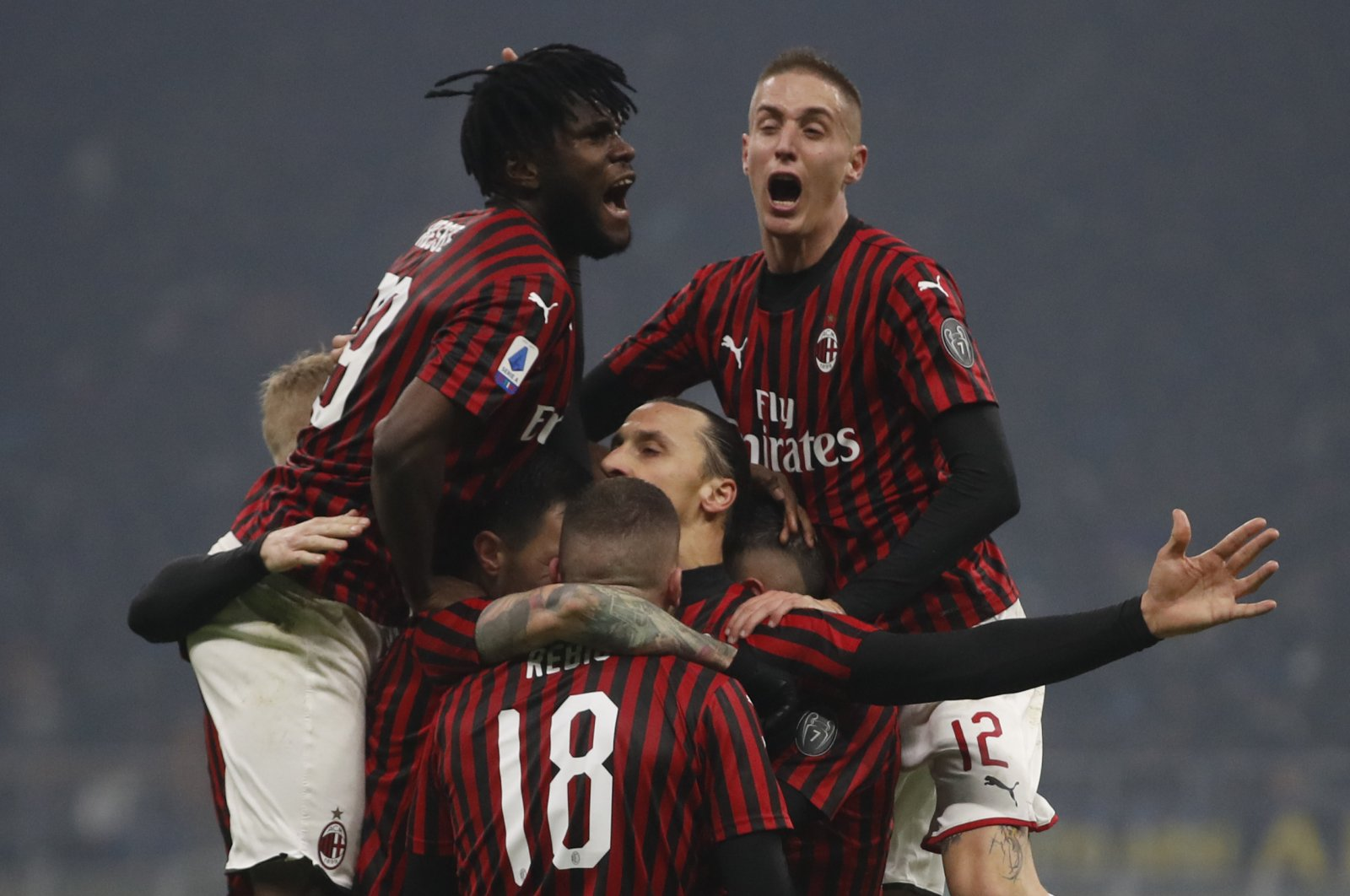 AC Milan's Zlatan Ibrahimovic (C) celebrates with his teammates after scoring his side's second goal during the Serie A match against Inter Milan, in Milan, Italy, Feb. 9, 2020. (AP Photo)