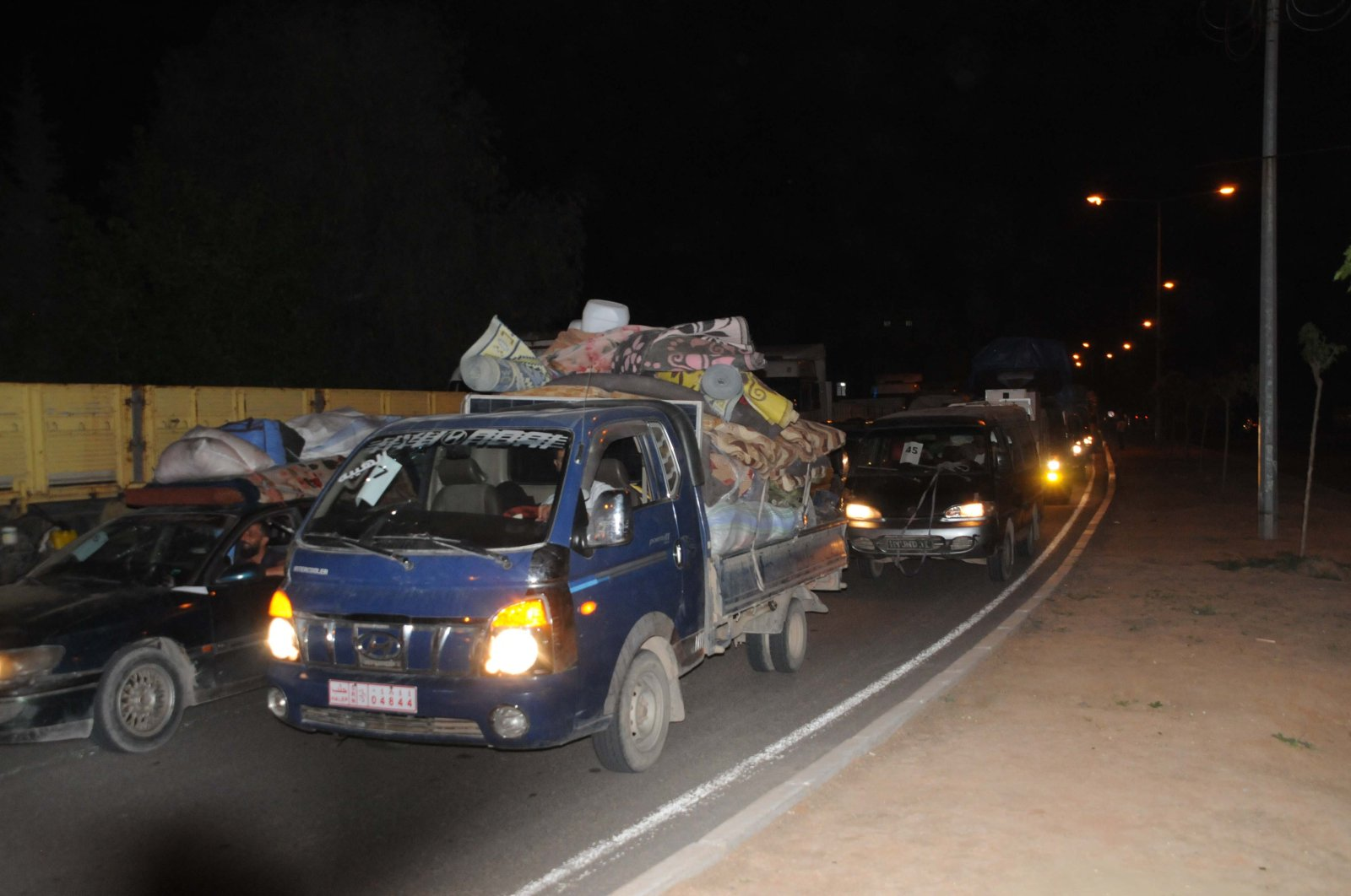 Some 150 vehicles carrying displaced Syrian families moved from Afrin to Tal Abyad, April 20, 2020. (DHA)