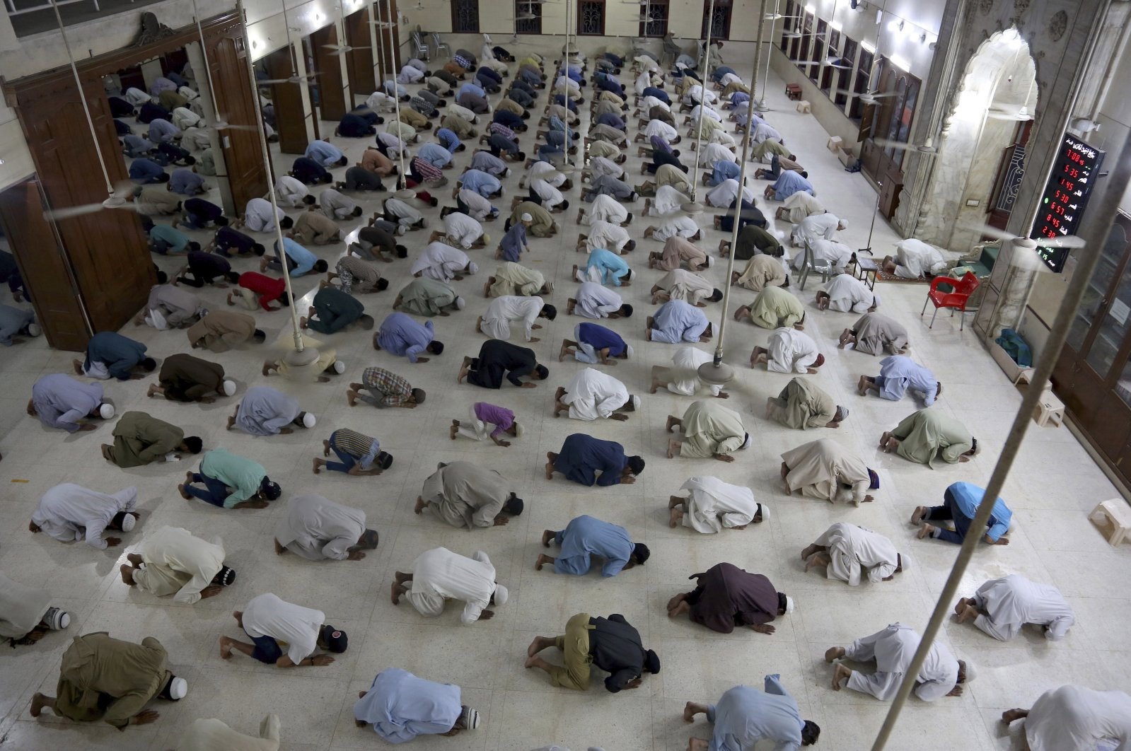 People attend evening prayers while maintaining social distancing to help avoid the spread of the coronavirus, at a mosque in Karachi, Pakistan, April 19, 2020. (AP Photo)