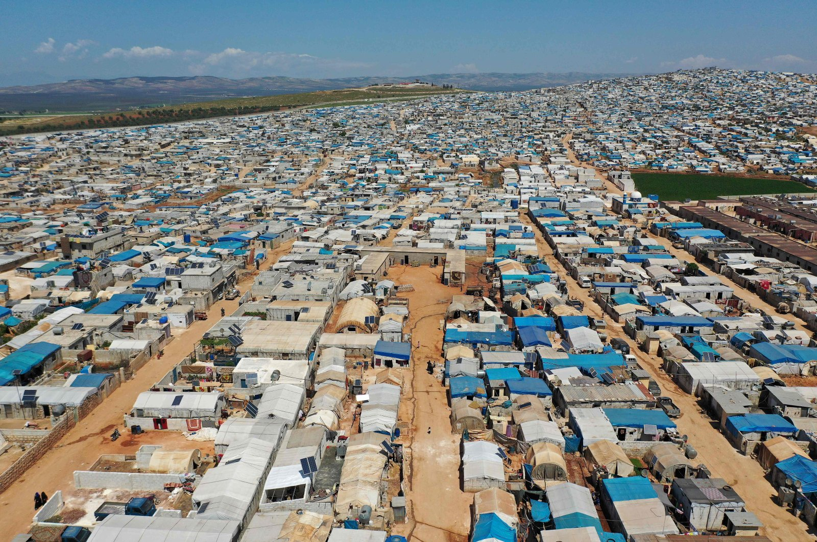 An aerial view shows the Atme camp for displaced Syrians close to the border with Turkey in Syria's northwestern Idlib province, on April 19, 2020. (AFP)