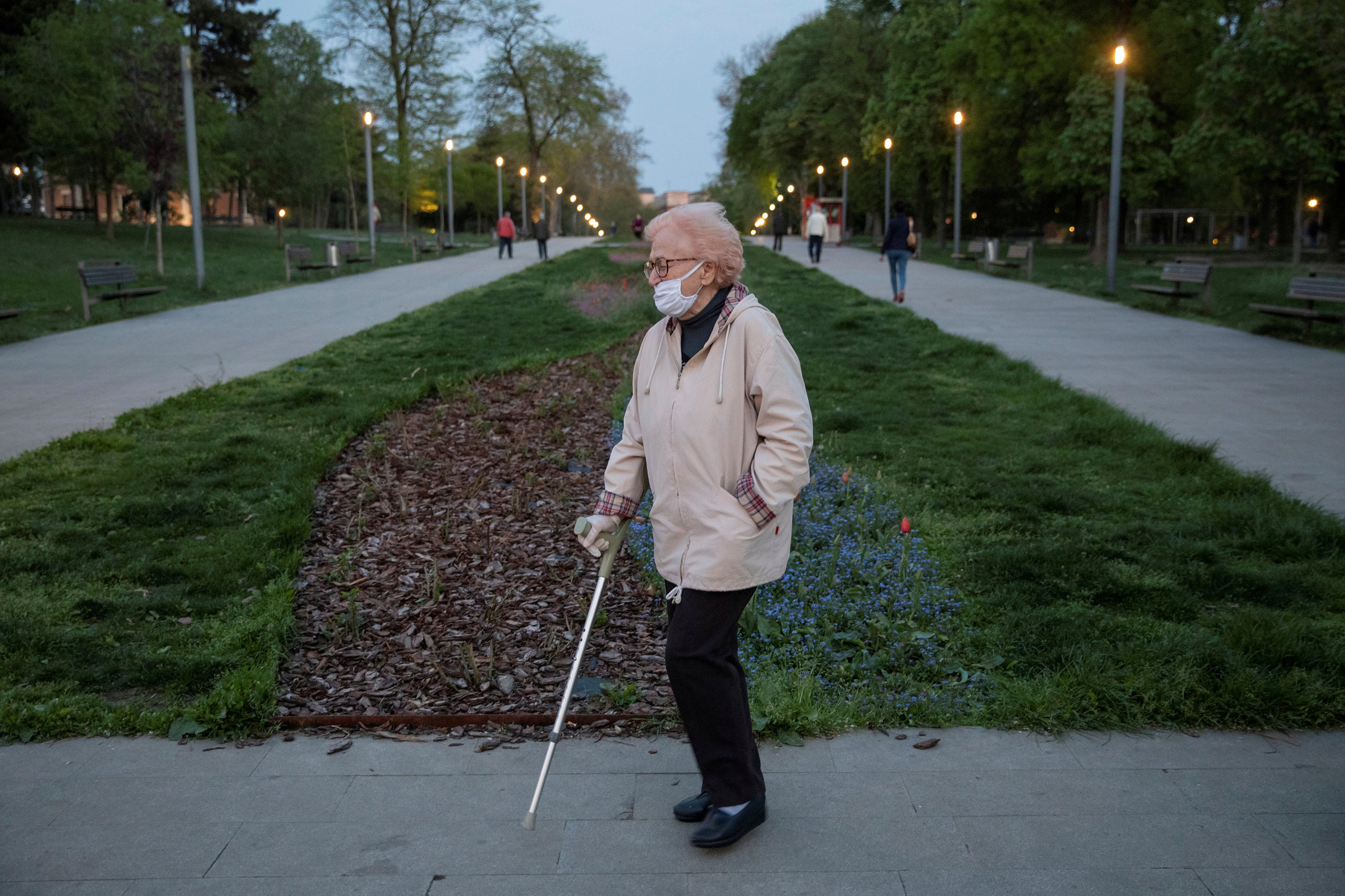 An elderly woman walks in a park during a curfew imposed to prevent the spread of coronavirus disease (COVID-19) in Belgrade, Serbia, April 21, 2020. (REUTERS Photo)