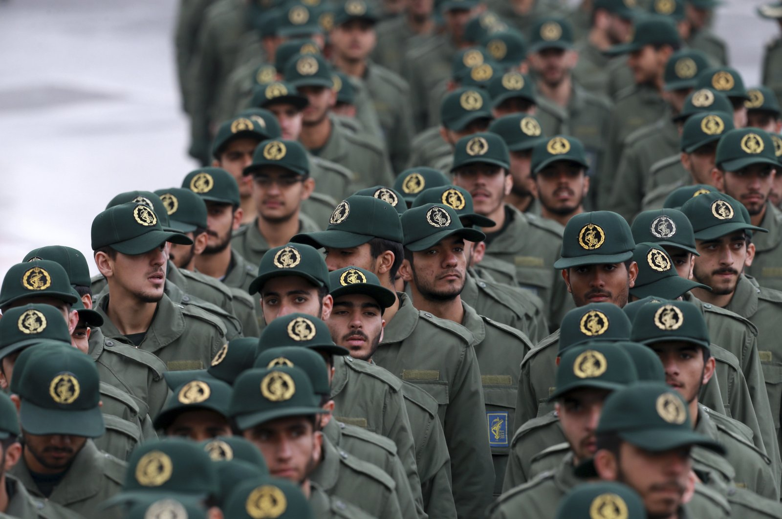 In this Feb, 11, 2019 file photo, Iranian Revolutionary Guard members arrive for a ceremony celebrating the 40th anniversary of the Islamic Revolution, at the Azadi, or Freedom, Square, in Tehran, Iran. (AP Photo)