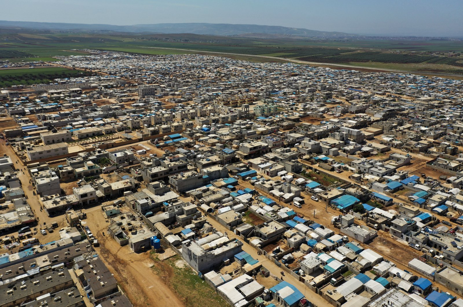 A large refugee camp on the Syrian side of the border with Turkey, near the town of Atma, in Idlib province, Syria, April 19, 2020. (AP Photo)