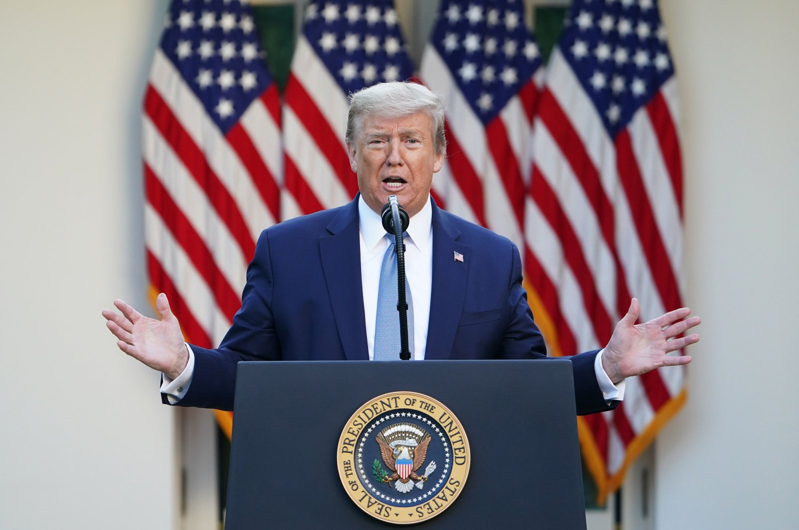 U.S. President Donald Trump gestures as he speaks during the daily briefing on the novel coronavirus in the Rose Garden of the White House, in Washington, D.C., U.S., April 15, 2020. (AFP Photo)