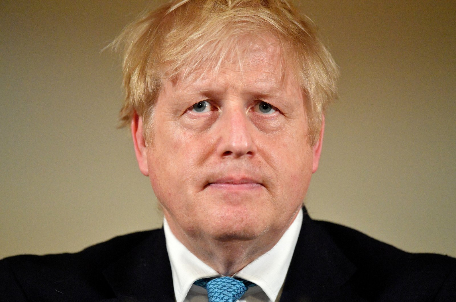 British Prime Minister Boris Johnson looks on during a coronavirus disease (COVID-19) news conference inside 10 Downing Street, London, Britain March 19, 2020. (Reuters Photo)