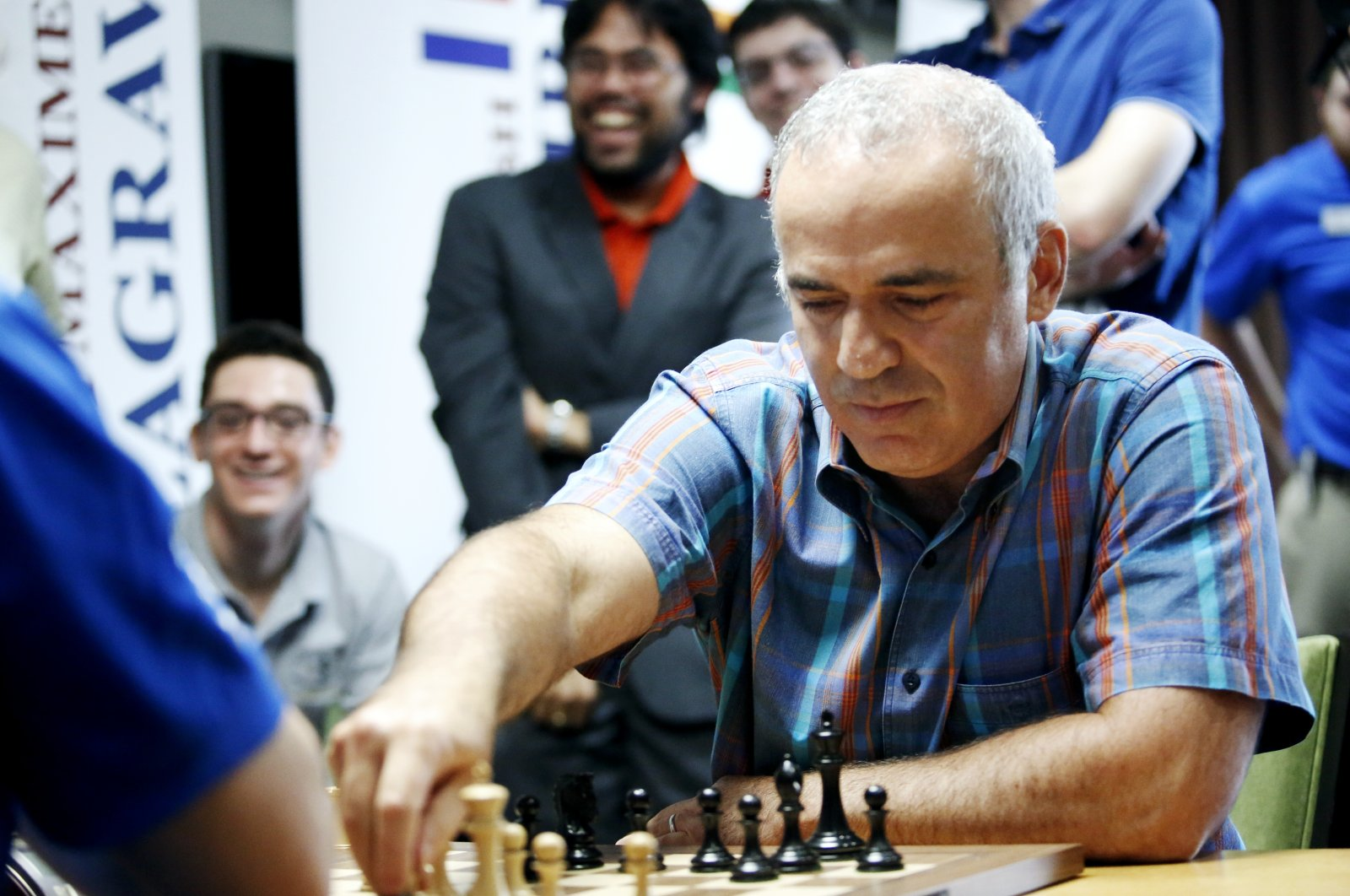 World chess legend Garry Kasparov makes a move during a series of rapid and blitz exhibition games called Ultimate Moves, St. Louis, Missouri, United States, Sept. 3, 2015. (AP Photo)