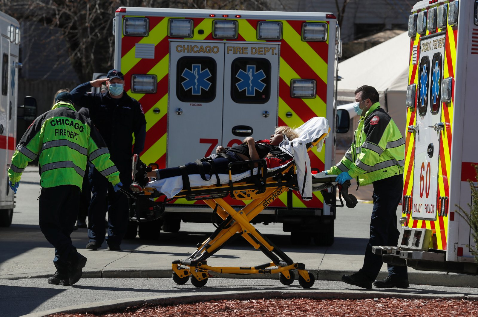 A woman is taken from a Chicago Fire Department ambulance into the emergency room at Roseland Community Hospital, as the spread of the coronavirus disease (COVID-19) continues, in the South Side of Chicago, Illinois, U.S., April 21, 2020. (Reuters Photo)