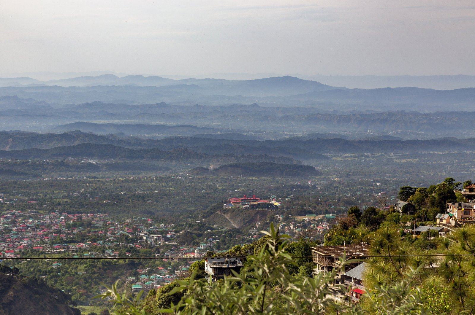 In this Friday, April 10, 2020, photo, Himachal Pradesh Cricket Association and the distant hills are clearly visible during lockdown to control the spread of the coronavirus in Dharmsala, India. (AP Photo)