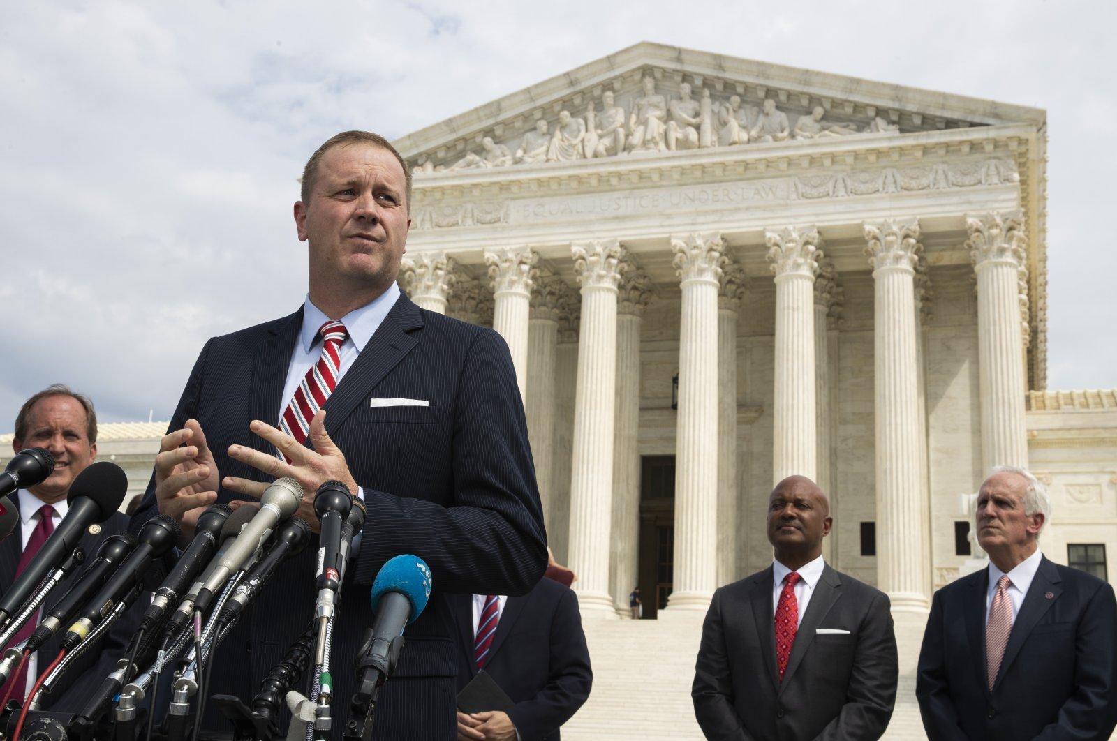 Missouri Attorney General Eric Schmitt speaks in front of the U.S. Supreme Court in Washington D.C., U.S., Sept. 9, 2019. (AP Photo)