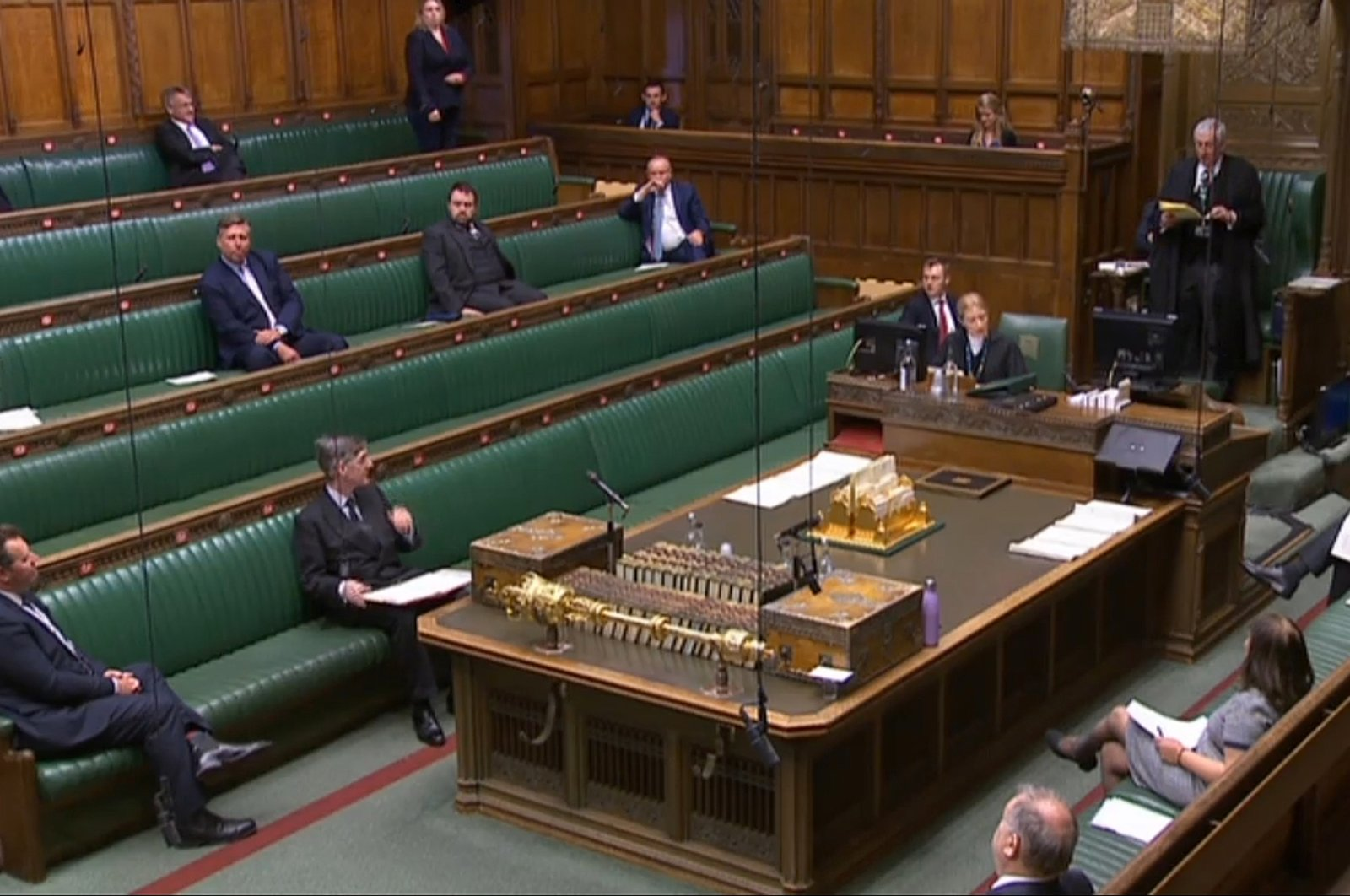 A video grab from footage broadcast by the UK Parliament's Parliamentary Recording Unit (PRU) shows Members of Parliament sitting in the Chamber in the House of Commons, in London on April 21, 2020, where social distancing measures have been put in place due to the novel coronavirus COVID-19 pandemic. (AFP PHOTO/PRU)