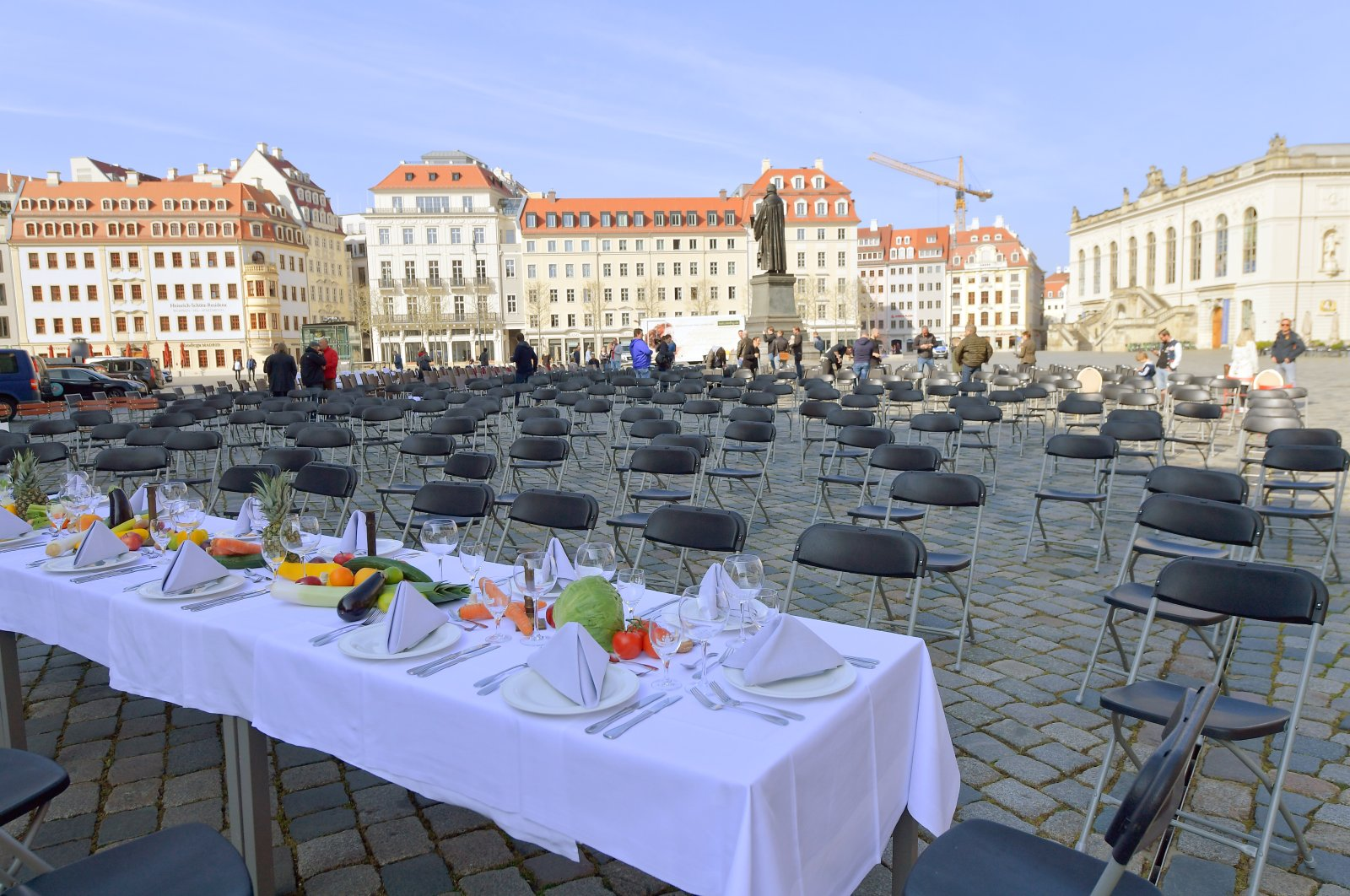 Empty chairs and decorated tables are set up in Neumarkt square to call attention to the difficult situation of hotel and restaurant owners as the spread of the coronavirus continues, Dresden, Germany, April 17, 2020. (Reuters Photo)