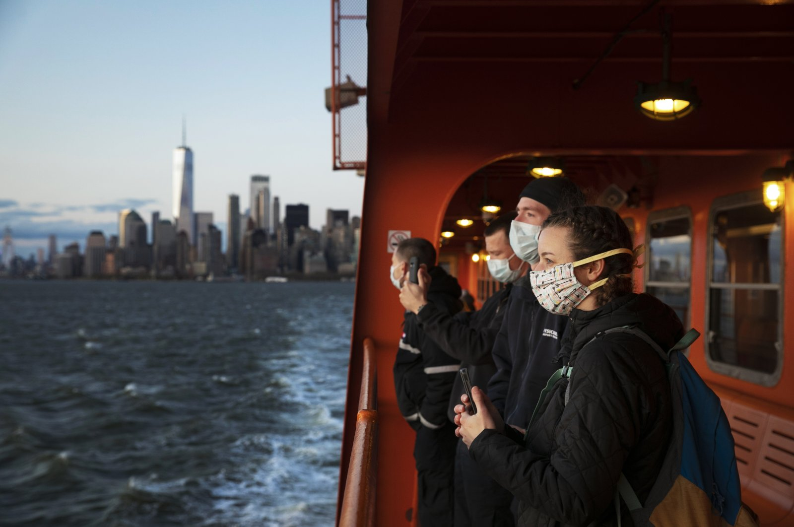 A group of emergency medical technicians who have come to New York to assist ambulance crews during the coronavirus pandemic ride the Staten Island Ferry, in New York, April 21, 2020. (AP Photo)