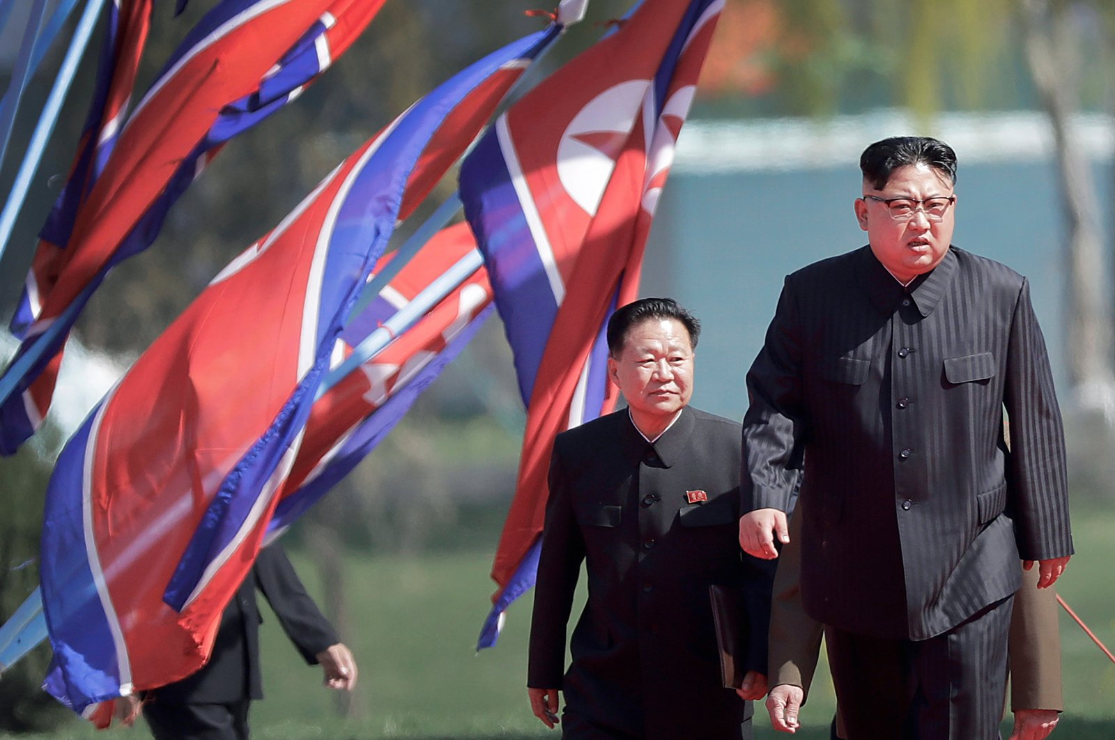 In this April 13, 2017, file photo, North Korean leader Kim Jong Un, right, and Choe Ryong Hae, vice-chairman of the central committee of the Workers' Party, arrive for the official opening of the Ryomyong residential area, in Pyongyang, North Korea. (AP Photo)
