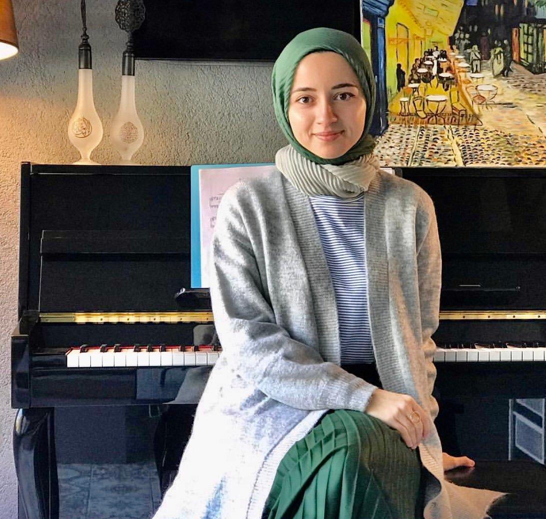 Büşra Kayıkçı poses in front of her piano. (Courtesy of Büşra Kayıkçı)