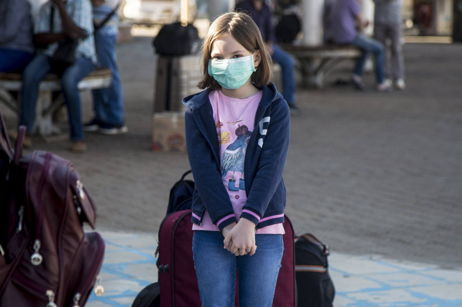 A Turkish girl waits at Khartoum International Airport to board a Turkish Airlines flight as part of Ankara's plan to evacuate its citizens, Khartoum, Sudan, April 22, 2020. (AA Photo)