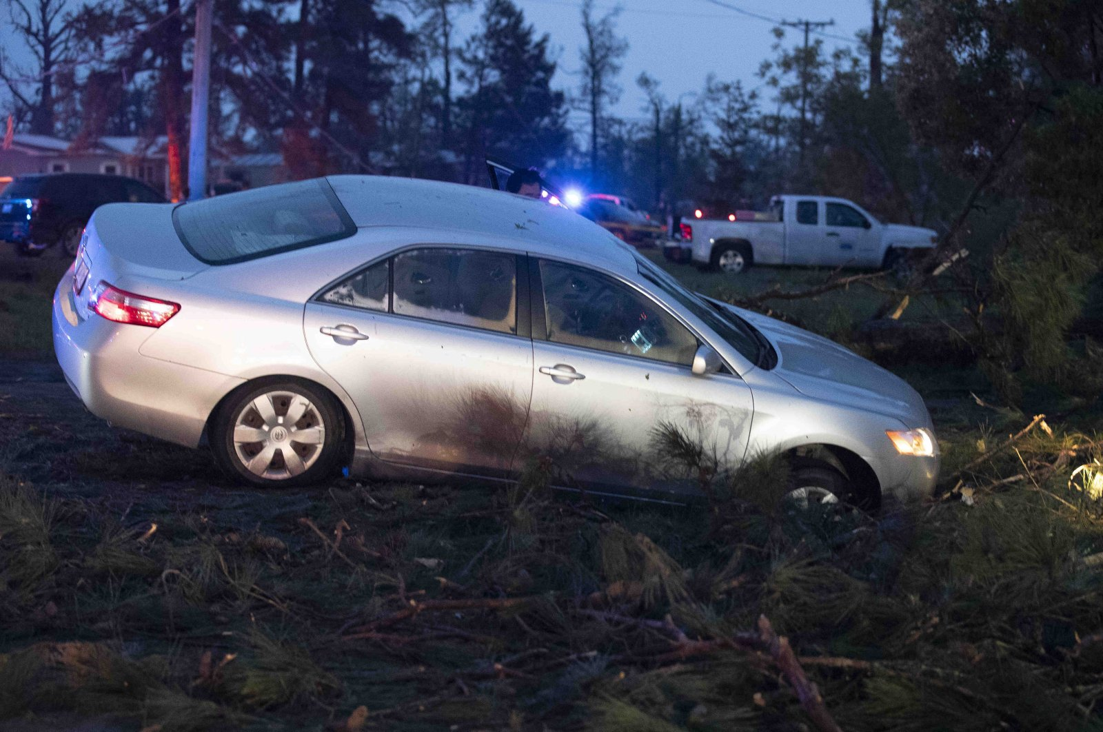 A car is seen in a ditch in Onalaska, Texas, after a tornado touched down in the area Wednesday, April 22, 2020. (AP Photo)