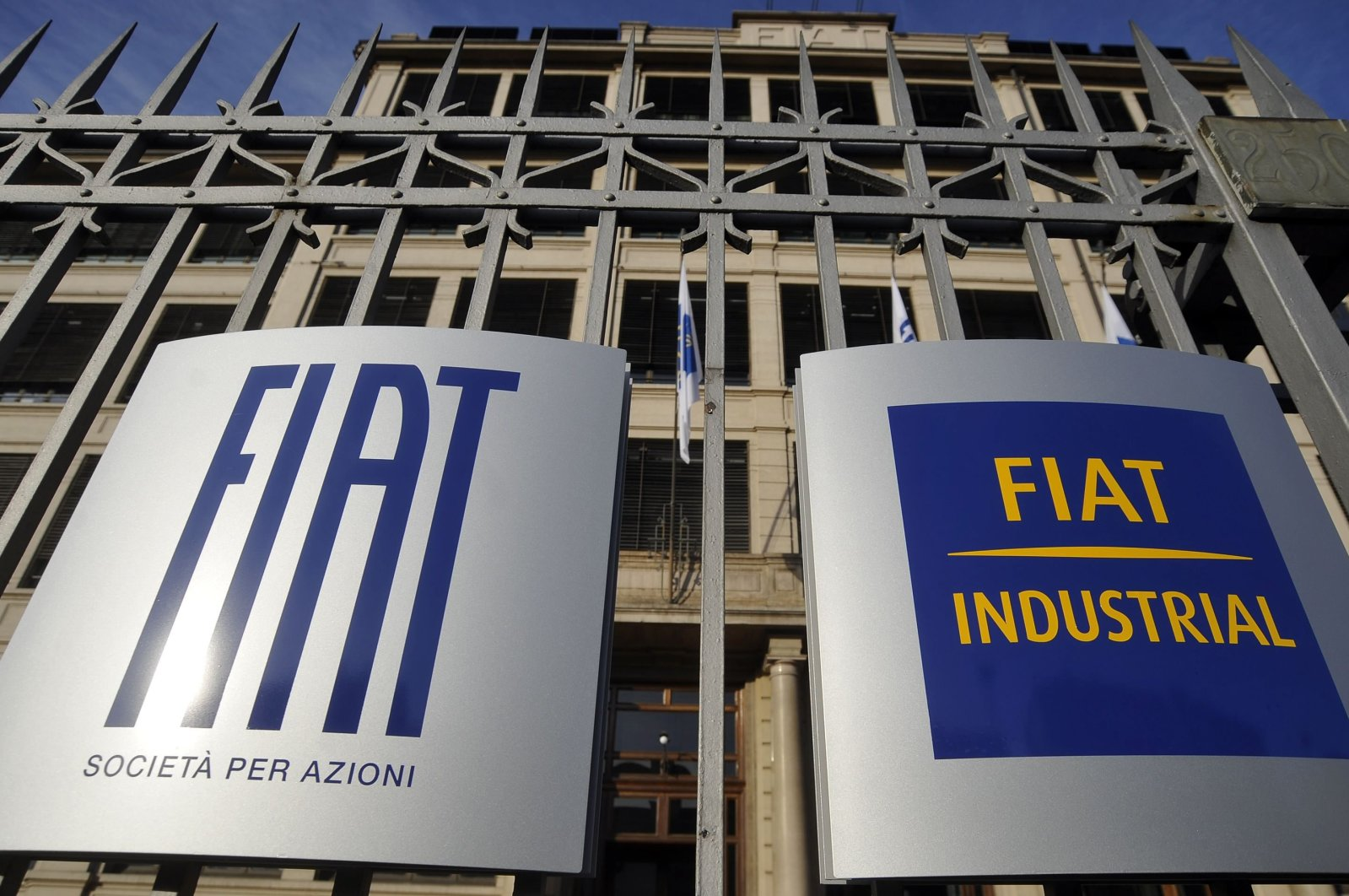Fiat's logos are seen at the main entrance of the Fiat headquarters in Turin, Italy, Jan. 12, 2011. (Reuters Photo)