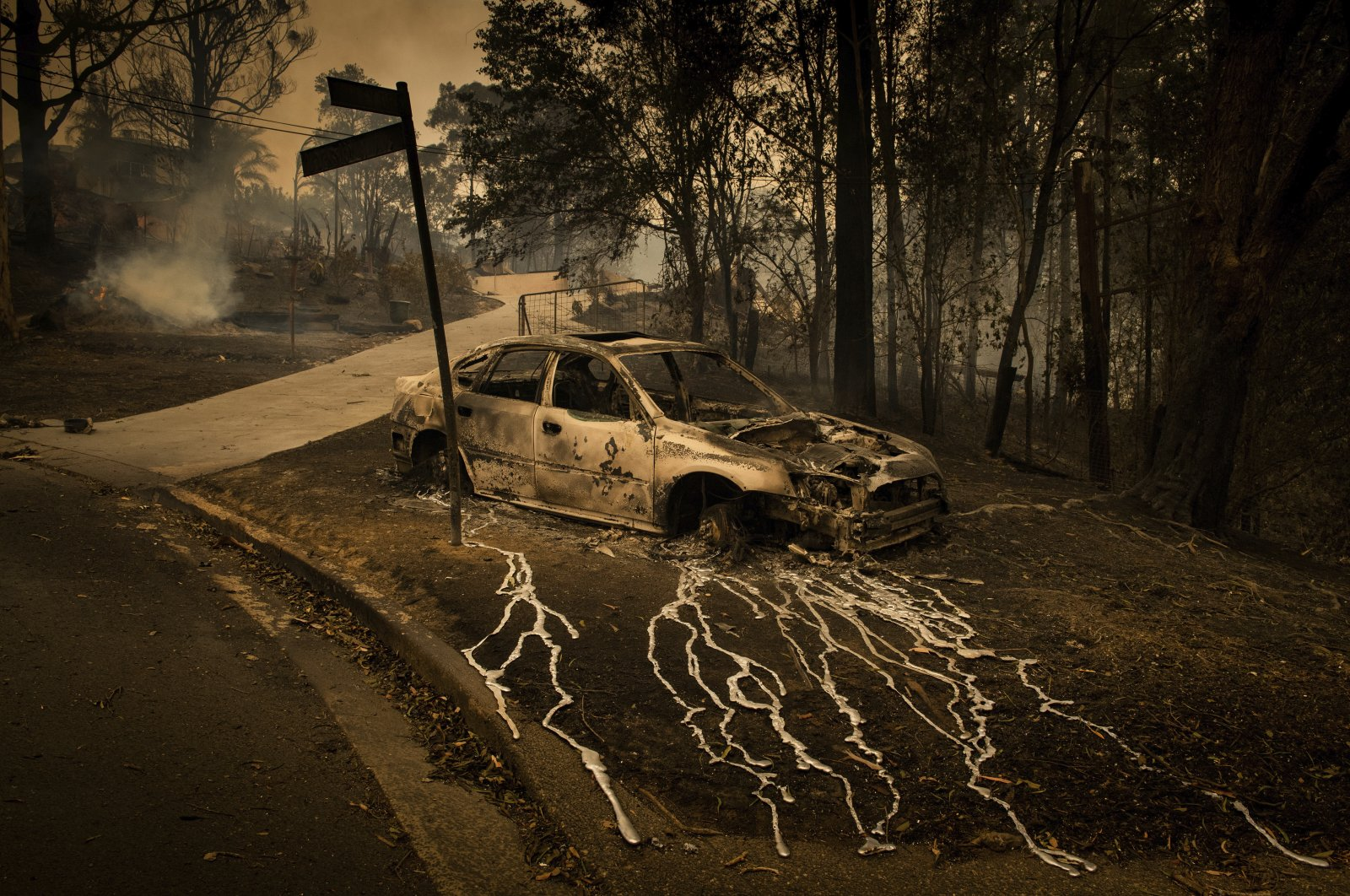 Aluminum, which melts at 660.3 C, has streamed from a burning car in Conjola Park, a town where bushfires razed more than 89 properties, in New South Wales, Australia, Dec. 31, 2019. (Matthew Abbott, Panos Pictures for The New York Times, World Press Photo via AP)