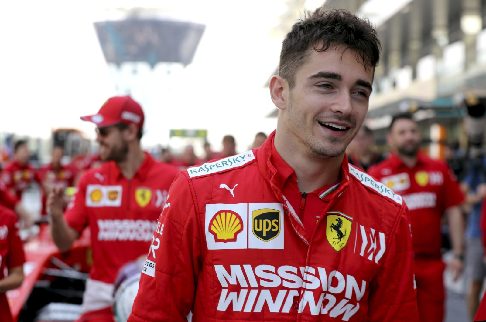 Ferrari driver Charles Leclerc walks through pit lanes after posing for an end season team picture, Abu Dhabi, UAE, Nov. 30, 2019. (AP Photo)