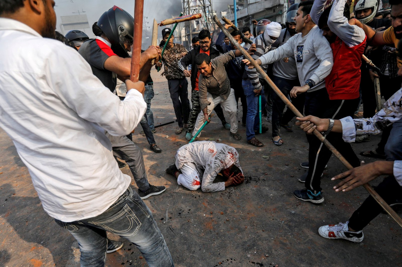 A group of men chanting pro-Hindu slogans beat Mohammad Zubair, 37, who is Muslim, during protests sparked by a new citizenship law in New Delhi, Feb. 24, 2020. (Reuters Photo)