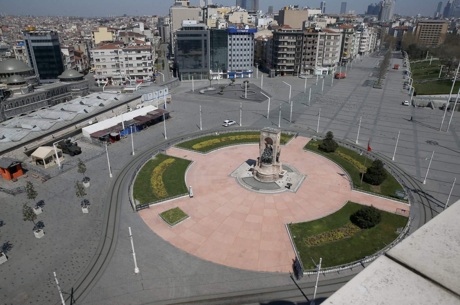 Istanbul's iconic Taksim Square was left deserted as the government declared a curfew over the weekend, Istanbul, Turkey, April 18, 2020. (AP Photo)