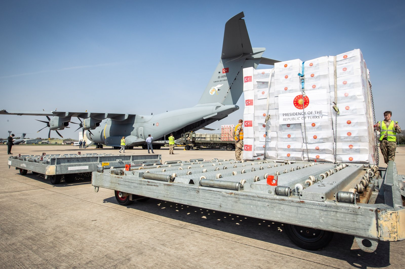 Crucial supplies of personal protective equipment (PPE) for medical staff are delivered from Turkey into a Royal Air Force base for distribution around the country, amid the coronavirus disease, in Carterton, Britain, April 10, 2020. (REUTERS)