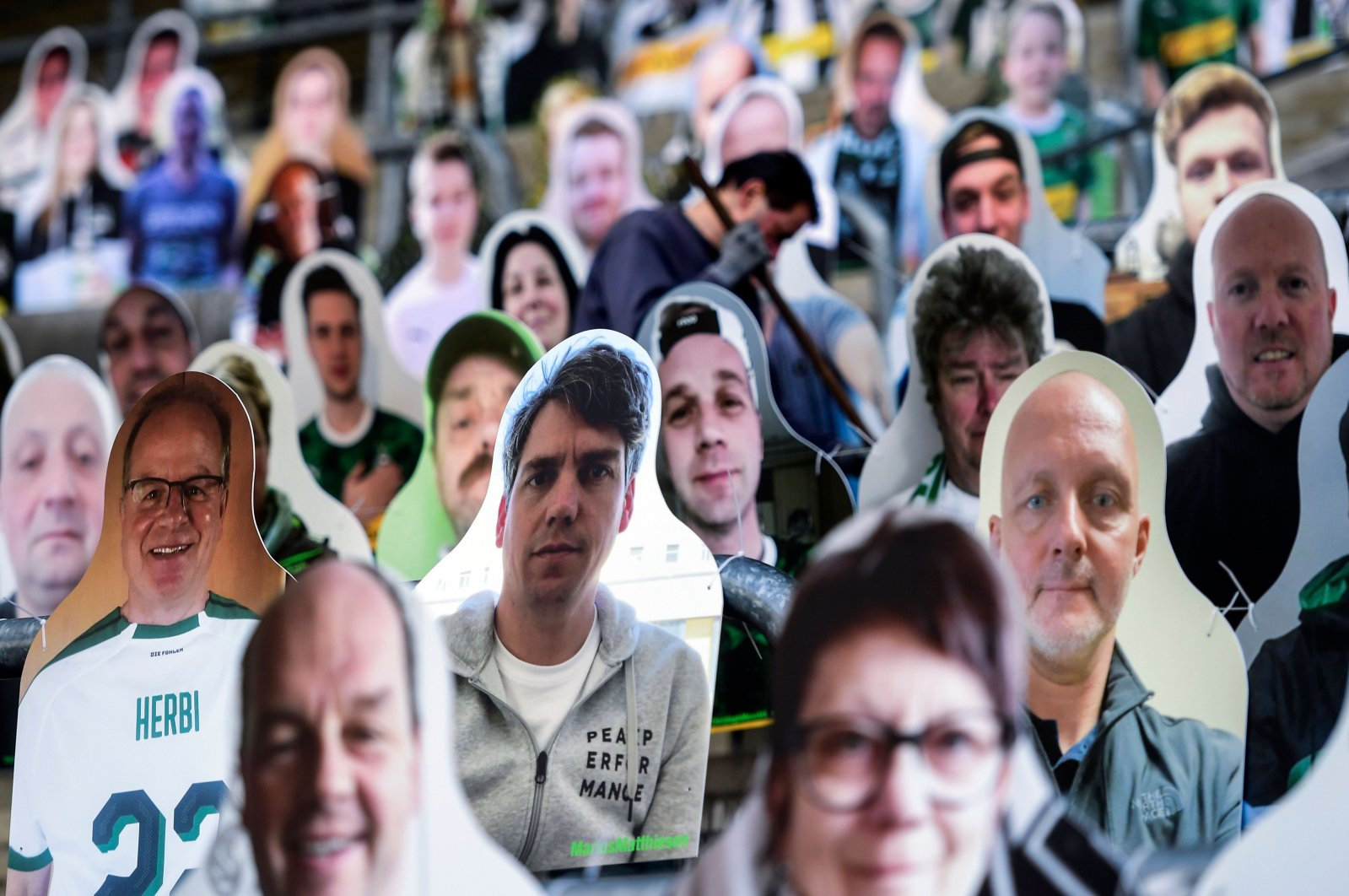 In this April 16, 2020, file photo cardboard cut-outs with portraits of Borussia Moenchengladbach's supporters are seen at the Borussia Park football stadium in Moenchengladbach, western Germany, amid the novel coronavirus COVID-19 pandemic. (AFP Photo)