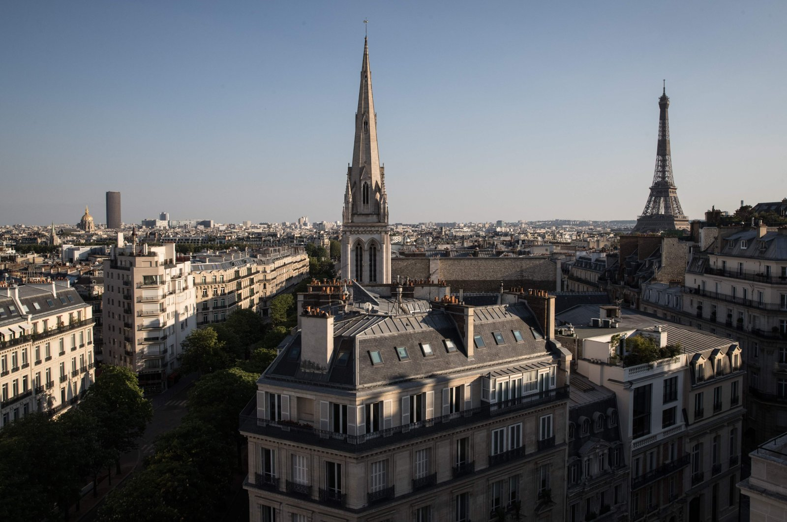 This picture, taken on April 23, 2020, shows (From L) The Invalides, the Montparnasse tower, the American Cathedral and the Eiffel Tower, in Paris, on the 38th day of a lockdown in France aimed at curbing the spread of the COVID-19 disease, caused by the novel coronavirus. (AFP Photo)