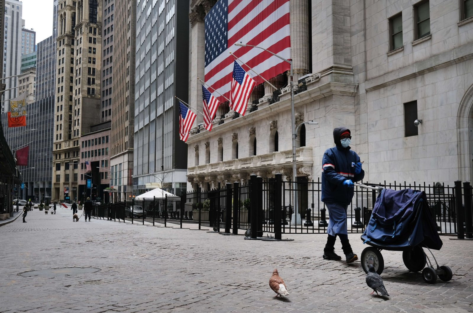 A person walks on Wall Street as the coronavirus keeps financial markets and businesses mostly closed in New York City, April 23, 2020. (AFP Photo)